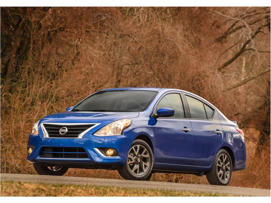a blue car parked in front of a house: 2018 Nissan Versa