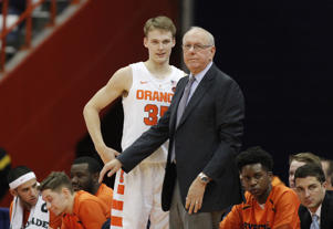 CAPTION: Syracuse head coach Jim Boeheim, right, talks with his son Buddy Boeheim, left, during the second half of an NCAA college basketball game against Saint Rose in Syracuse, N.Y., Thursday, Oct. 25, 2018.