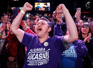 Supporters of Democratic congressional candidate Alexandria Ocasio-Cortez celebrate her victory at her midterm election night party in New York City, U.S. November 6, 2018. REUTERS/Andrew Kelly - RC1B46CF26F0