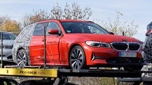 a red and black truck sitting on top of a car: BMW 3 Series Touring Spy Photos