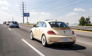 a car driving down a street: 2019 Volkswagen Beetle Final Edition