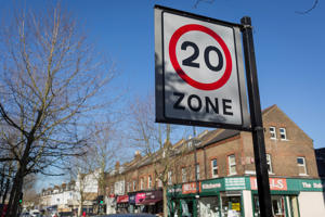 A 20mph speed limit signpost and local shops on Lordship Lane, in East Dulwich, on 15th March 2017, London borough of Southwark, England. (Photo by Richard Baker / In Pictures via Getty Images)