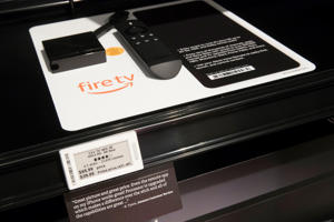 A review of the Amazon Fire TV as well as a tag displaying the regular price and the Amazon Prime customer price are on display at the Amazon 4-star store in the Soho neighborhood of New York, Thursday, Sept. 27, 2018. Amazon is expanding its physical presence again, this time opening a 4,000-square-foot store that sells a wide range of products, including shower curtains, Hallmark cards and baby bottles. (AP Photo/Mary Altaffer)