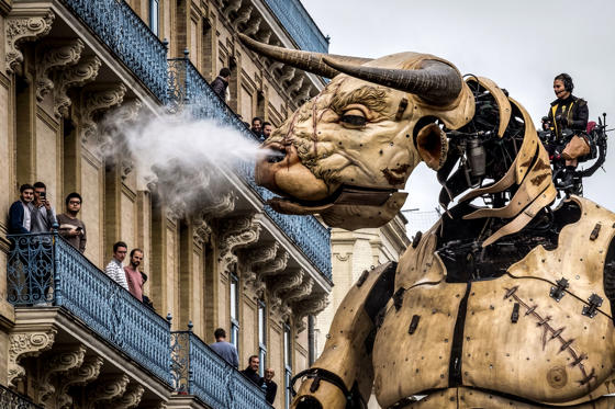 """Slide 1 of 37: """"Asterion,"""" a giant Minotaure performs in the street of Toulouse as part of French street theatre company La Machine show """"Le Gardien du Temple"""" on November 2, 2018 in Toulouse city center. (Photo by ERIC CABANIS / AFP) (Photo credit should read ERIC CABANIS/AFP/Getty Images)"""