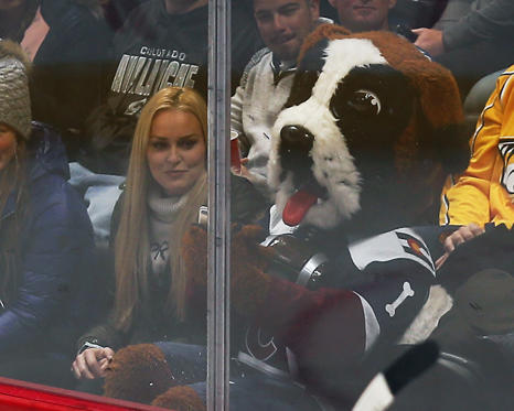 Slide 1 of 99: DENVER, CO - NOVEMBER 07: Bernie, the Avs mascot checks out Lindsey Vonn's phone during a regular season game between the Colorado Avalanche and the visiting Nashville Predators on November 7, 2018 at the Pepsi Center in Denver, CO. (Photo by Russell Lansford/Icon Sportswire/Getty Images)