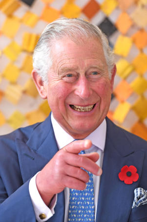 ACCRA, GHANA - NOVEMBER 05:  Prince Charles, Prince of Wales looks at artwork made from recycled plastics as he attends a plastics event at Sandbox on day six of his trip to west Africa with the Duchess of Cornwall on November 5, 2018 in Accra, Ghana. (Photo by Joe Giddens - WPA Pool/Getty Images)