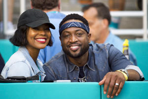MIAMI GARDENS, FL - OCTOBER 14: Miami Heat basketball player Dwayne Wade and his wife Gabrielle Union smile as they watch the NFL football game between the Chicago Bears and the Miami Dolphins on October 14, 2018 at the Hard Rock Stadium in Miami Gardens, FL. (Photo by Doug Murray/Icon Sportswire via Getty Images)