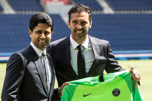 PSG's new signing goalkeeper Gianluigi Buffon, right, poses with Paris Saint-Germain's Qatari chairman and CEO Nasser Al-Khelaifi during his official presentation at the Parc des Princes stadium in Paris, France, Monday, July 9, 2018. Free agent Gianluigi Buffon signed for Paris Saint-Germain last Friday. The veteran goalkeeper penned a one-year deal at the French champion with the option for an additional season. (AP Photo/Jean-Francois Badias)