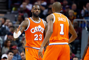 CAPTION: CLEVELAND, OH - JANUARY 29: LeBron James #23 of the Cleveland Cavaliers celebrates late in the game with James Jones #1 while playing the Oklahoma City Thunder at Quicken Loans Arena on January 29, 2017 in Cleveland, Ohio.