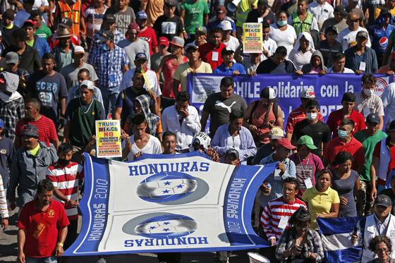 Slide 2 of 60: A group of Central American migrants, representing the thousands participating in a caravan trying to reach the U.S. border, undertake an hours-long march to the office of the United Nations' humans rights body in Mexico City, Thursday, Nov. 8, 2018. Members of the caravan which has stopped in Mexico City demanded buses Thursday to take them to the U.S. border, saying it is too cold and dangerous to continue walking and hitchhiking.(AP Photo/Rebecca Blackwell)