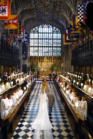 Prince of Wales walking Meghan Markle up the aisle of St George's Chapel at Windsor Castle for her wedding to Prince Harry.