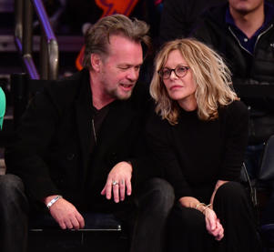 NEW YORK, NY - DECEMBER 25: John Mellencamp and Meg Ryan attend the New York Knicks Vs Philadelphia 76ers game at Madison Square Garden on December 25, 2017 in New York City. (Photo by James Devaney/Getty Images)