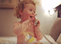 This impossibly cute kid just loves to gossip on the phone