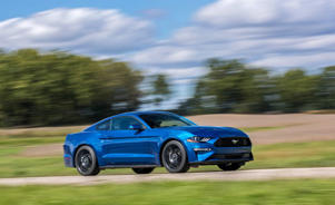 a blue car parked on the side of a road: The Mustang's 10-Speed Automatic Makes It a Quicker but Not Better Pony