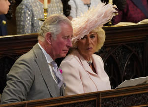 The Prince of Wales and the Duchess of Cornwall take their seats in St George's Chapel at Windsor Castle ahead of the wedding of Prince Harry and Meghan Markle.