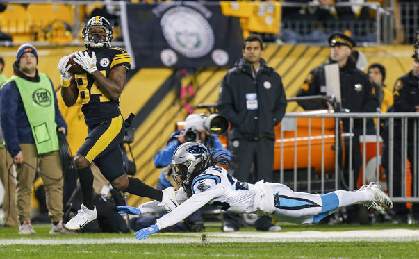 Slide 1 of 18: PITTSBURGH, PA - NOVEMBER 08: Antonio Brown #84 of the Pittsburgh Steelers catches a pass in front of Donte Jackson #26 of the Carolina Panthers for a 53 yard touchdown during the second quarter in the game at Heinz Field on November 8, 2018 in Pittsburgh, Pennsylvania. (Photo by Justin K. Aller/Getty Images)