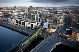 Dublin commuter train heads north crossing the river Liffey from Tara street station.