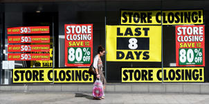 A pedestrian walks past a shop with a closing down sale promotion in Liverpool, north west England, on August 17, 2016.  From computers and cars to carpets and food, Britain's decision to leave the EU is beginning to hit consumers in the pocket, having already spread uncertainty through the property market. The consequences of the shock vote have so far been mainly theoretical, but recent data suggest that the country's tumbling currency is about to reach the High Street. The Office for National Statistics publishes retail sales figures for July on August 18, 2016.  / AFP PHOTO / PAUL ELLIS        (Photo credit should read PAUL ELLIS/AFP/Getty Images)