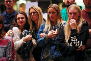 Mourners attend a vigil for the victims of the mass shooting, at the Thousand Oaks Civic Arts Plaza in Thousand Oaks, California, U.S. November 8, 2018.