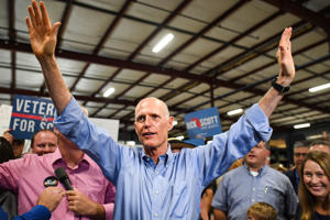 Florida Governor and Republican Senate candidate Rick Scott, shown at an Orlando rally on Nov. 2, 2018, sued election officials in Broward and Palm Beach counties.
