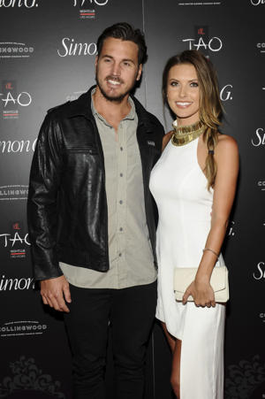 Corey Bohan and Audrina Patridge arrive at the annual Simon G Soiree at TAO in Las Vegas. E! News reports the couple married on Saturday, Nov. 5, 2016 in Hawaii.  (Photo by Brenton Ho/Powers Imagery/Invision/AP, File)