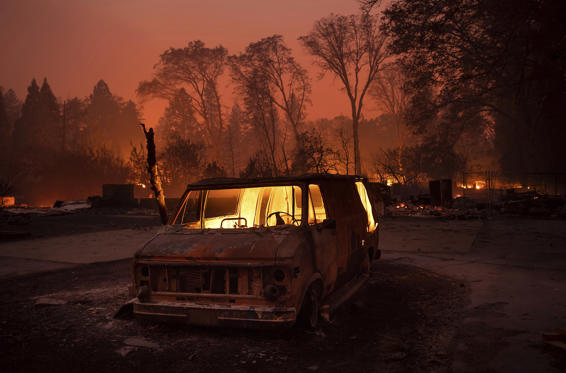 Slide 1 of 62: Flames burn inside a van as the Camp Fire tears through Paradise, Calif., on Thursday, Nov. 8, 2018. Tens of thousands of people fled a fast-moving wildfire Thursday in Northern California, some clutching babies and pets as they abandoned vehicles and struck out on foot ahead of the flames that forced the evacuation of an entire town and destroyed hundreds of structures. (AP Photo/Noah Berger)