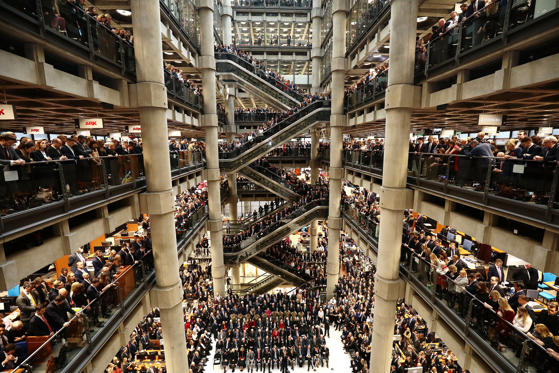 Slide 1 of 36: Brokers and underwriters line the balconies and escalators of the Lloyd's of London building during a service of Remembrance on November 9, 2018 in London, England. The service at Lloyd's is observed with the ringing of the Lutine Bell, the laying of wreaths before the Book of Remembrance and a two minute silence. The armistice ending the First World War between the Allies and Germany was signed at Compiègne, France on eleventh hour of the eleventh day of the eleventh month - 11am on the 11th November 1918. Remembrance Day will be commemorated with special attention payed to this year's centenary