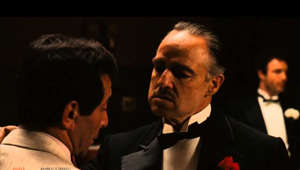 "a man in a suit and tie: Visit: http://www.quizandquestions.com For A Movie Quiz Godfather Quiz: http://www.quizandquestions.com/the-godfather-quiz Godfather Word Search: http://www.quizandquestions.com/godfather-word-search I'm Gonna Make Him An Offer He Can't Refuse Script - http://www.quizandquestions.com/the-godfather-johnny-fontane Subscribe: http://goo.gl/Mv1MJ Watch The Godfather Online FREE: http://goo.gl/mf3od Buy Movie: http://goo.gl/3mSVs Follow Us On Facebook: http://www.facebook.com/QuizAndQuestions Follow Us On Twitter: https://twitter.com/QuizAQuestions  Godfather Movie Scene: The scene where Johnny Fontane (Al Martino) has been crying and asks Don Corleone (Marlon Brando) for help to get him in the new movie produced by Jack Waltz (John Marley). Don Corleone tells him perhaps the best movie quote in history ""I'm Gonna Make Him An Offer He Can't Refuse"".  Movie Description: Throughout his long, wandering, often distinguished career Francis Ford Coppola has made many films that are good and fine, many more that are flawed but undeniably interesting, and a handful of duds that are worth viewing if only because his personality is so flagrantly absent. Yet he is and always shall be known as the man who directed the Godfather films, a series that has dominated and defined their creator in a way perhaps no other director can understand. Coppola has never been able to leave them alone, whether returning after 15 years to make a trilogy of the diptych, or re-editing the first two films into chronological order for a separate video release, as is the case here. The films are our very own Shakespearean cycle: they tell a tale of a vicious mobster and his extended personal and professional families (once the stuff of righteous moral comeuppance), and they dared to present themselves with an epic sweep and an unapologetically tragic tone. Murder, it turned out, was a serious business. The first film remains a towering achievement, brilliantly cast and conceived. The entry of Michael Corleone into the family business, the transition of power from his father, the ruthless dispatch of his enemies--all this is told with an assurance that is breathtaking to behold. And it turned out to be merely prologue; two years later The Godfather, Part II balanced Michael's ever-greater acquisition of power and influence during the fall of Cuba with the story of his father's own youthful rise from immigrant slums. The stakes were higher, the story's construction more elaborate, and the isolated despair at the end wholly earned. (Has there ever been a cinematic performance greater than Al Pacino's Michael, so smart and ambitious, marching through the years into what he knows is his own doom with eyes open and hungry?) The Godfather, Part III was mostly written off as an attempted cash-in, but it is a wholly worthy conclusion, less slow than autumnally patient and almost merciless in the way it brings Michael's past sins crashing down around him even as he tries to redeem himself.  Cast: James Caan, Richard S. Castellano, Robert Duvall, Al Pacino, Abe Vigoda, Marlon Brando, John Marley, Richard Conte, Al Lettieri, Diane Keaton  The Godfather - I'm Gonna Make Him An Offer I Can't Refuse: http://www.quizandquestions.com/slide-view/the-godfather-im-gonna-make-him-an-offer-he-cant-refuse/"