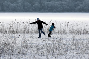 NOTE ALTERNATE CROP A couple skate on a frozen Lake of Menteith on Christmas Day. (Photo by Andrew Milligan/PA Images via Getty Images)