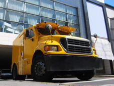 Yellow armored truck in front of a bank