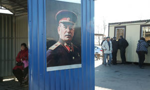 A portrait of Joseph Stalin on a bus stop at the Aleksandrovka crossing on the Russian-Ukrainian border in a file photo
