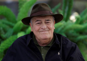 "FILE - In this file photo taken on Oct. 18, 2012, Italian film director Bernardo Bertolucci poses for photographers during a photo call in Rome. Bertolucci, who won Oscars with ""The Last Emperor"" and whose erotic drama ""Last Tango in Paris"" enthralled and shocked the world, has died at the age of 77. Bertolucci's press office, Punto e Virgola, confirmed the death Monday, Nov. 26, 2018, in an email to The Associated Press. (AP Photo/Andrew Medichini)"
