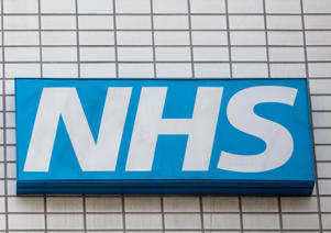 An NHS sign sits on the outside of Guy's and St Thomas' Hospital on January 3, 2018 in London, England.