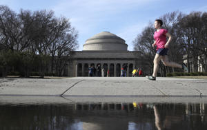 "A runner passes the ""Great Dome"" atop of building 10 on the campus of the Massachusetts Institute of Technology in Cambridge, Mass.,Monday, April 3, 2017. (AP Photo/Charles Krupa)"