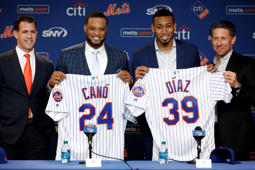 New York Mets' Robinson Cano, second left, and Edwin Díaz, third left, pose with their new jerseys as they are introduced at a news conference at CitiField, in New York, Tuesday, Dec. 4, 2018. The Mets acquired eight-time All-Star second baseman Robinson Cano and major league saves leader Edwin Diaz from the Seattle Mariners in a seven-player trade Monday. They are joined by New York Mets General Manger Brodie Van Wagenen, left, and team COO Jeff Wilpon. (AP Photo/Richard Drew)