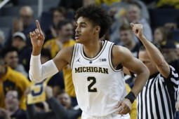 Michigan guard Jordan Poole reacts to hitting a basket against South Carolina in the first half of an NCAA college basketball game in Ann Arbor, Mich., Saturday, Dec. 8, 2018. (AP Photo/Paul Sancya)