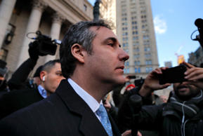 "Michael Cohen walks out of federal court, Thursday, Nov. 29, 2018, in New York, after pleading guilty to lying to Congress about work he did on an aborted project to build a Trump Tower in Russia., Cohen told the judge he lied about the timing of the negotiations and other details to be consistent with Trump's ""political message."" (AP Photo/Julie Jacobson)"