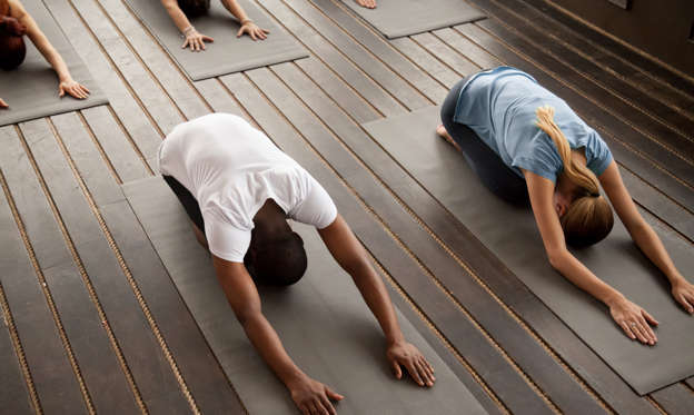幻灯片 13 - 2: Group of young sporty afro american and caucasian people practicing yoga lesson stretching in Child exercise, Balasana pose, working out, indoor, studio top view. Healthy lifestyle concept