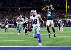 Dallas Cowboys wide receiver Amari Cooper (19) scores a 15-yard touchdown as Philadelphia Eagles' Rasul Douglas (32) watches in overtime of an NFL football game, in Arlington, Texas, Sunday, Dec. 9, 2018. Dallas won 29-23. (AP Photo/Roger Steinman)