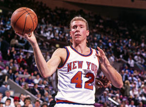 NEW YORK - 1993: Eric Anderson #42 of the New York Knicks passes against the Portland Trail Blazers during a game played circa 1993 at the Madison Square Garden in New York City.
