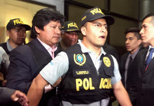 Peruvian Football Federation (FPF) president, Edwin Oviedo, is escorted by police after his detention in connection with an influence-peddling probe involving a former Supreme Court justice, a lead prosecutor said, in Lima, Peru December 6, 2018.