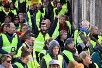 Yellow Vests (Gilets jaunes) shout slogans and wave placards as they participate in a protest rally against high fuel prices in Rochefort, south-western France on November 24, 2018, part of a movement  which has mushroomed into a widespread protest against stagnant spending power under the French President. - The demonstrations were sparked by an increase in diesel tax, justified as an anti-pollution levy by the government but have morphed into a broad opposition front to centrist Macron. (Photo by XAVIER LEOTY / AFP)        (Photo credit should read XAVIER LEOTY/AFP/Getty Images)