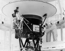 "FILE - In this Aug. 4, 1977 photo provided by NASA, the ""Sounds of Earth"" record is mounted on the Voyager 2 spacecraft in the Safe-1 Building at the Kennedy Space Center, Fla., prior to encapsulation in the protective shroud. Sunday, Aug. 20, 2017 marks the 40th anniversary of NASA's launch of Voyager 2, now almost 11 billion miles distant. (AP Photo/NASA)"