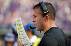 FILE - In this Sept. 23, 2018, file photo, Minnesota Vikings offensive coordinator John DeFilippo looks at his play sheet during the second half of an NFL football game against the Buffalo Bills, in Minneapolis. Minnesota's offense has been up and down this season under new coordinator DeFilippo and new quarterback Kirk Cousins, and the Vikings have had a lot of rough spots to try to smooth out down the final stretch. (AP Photo/Bruce Kluckhohn, File)