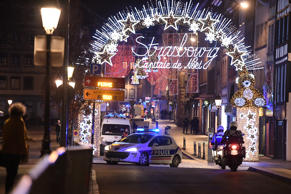 A police car drives in the streets of Strasbourg, eastern France, after a shooting breakout, on Dec. 11, 2018. At least two people have been killed and 11 critically wounded in a shooting in the French city of Strasbourg, police said, updating the number of victims.