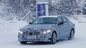 a car covered in snow: New Mercedes-Benz C-Class Spy Photo