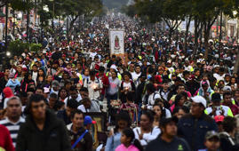 Thousands of Mexican pilgrims walk during the annual celebrations held at the Basilica of Guadalupe in Mexico City on December 11,  2018. - Mexicans people will celebrate on December 12, 2018, the apparition of the Our Lady of Guadalupe to Juan Diego in 1531. (Photo by RONALDO SCHEMIDT / AFP)        (Photo credit should read RONALDO SCHEMIDT/AFP/Getty Images)