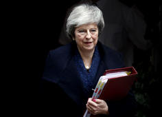Britain's Prime Minister Theresa May leaves 10 Downing Street to attend the weekly Prime Ministers' Questions session, in parliament in London, Wednesday, Dec. 12, 2018. (AP Photo/Frank Augstein)