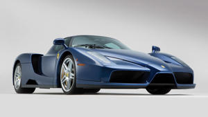 a close up of a car: 2004 Ferrari Enzo Blue