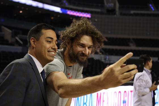 Slide 1 of 75: MEXICO CITY, MEXICO - DECEMBER 12: Robin Lopez of the Chicago Bulls takes a selfie with a media member during practice and media availability as part of the NBA Mexico Games 2018 on December 12, 2018 at Arena Ciudad de Mexico in Mexico City, Mexico. NOTE TO USER: User expressly acknowledges and agrees that, by downloading and/or using this photograph, user is consenting to the terms and conditions of the Getty Images License Agreement.  Mandatory Copyright Notice: Copyright 2018 NBAE (Photo by David Sherman/NBAE via Getty Images)